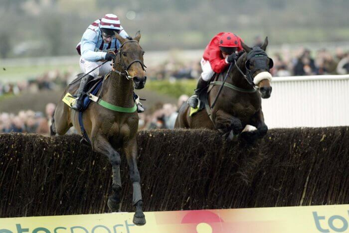 Best Mate and Jim Culloty clear the final fence, heading for their third Gold Cup victory.